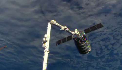 This framegrab image provided by NASA-TV shows the Cygnus spacecraft attached to an arm of the International Space Station on Sept. 29, 2013. /AP
