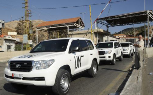 United Nations inspectors leave the Masnaa border crossing between Lebanon and Syria on Sept. 30, 2013. /Reuters