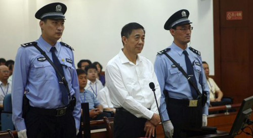 Bo Xilai (center) in court on charges of bribery, embezzlement and abuse of power in a case set in motion by his wifes murder of a British businessman. /AP
