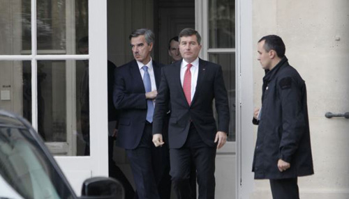 U.S Ambassador to France Charles Rivkin (center) leaves the Foreign Ministry in Paris, after being summoned on Oct. 21, 2013, to explain why America spied on one of its closest allies. /AP