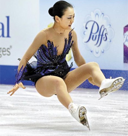 Mao Asada, of Japan, falls during her performance in the womens free skating routine at the Skate America figure skating competition in Detroit on Sunday. /AP-Newsis