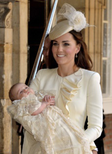 Kate, Duchess of Cambridge carries her son Prince George after his christening at the Chapel Royal in St. Jamess Palace in London on Oct. 23, 2013. /AP