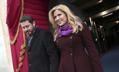 Singer Kelly Clarkson and Brandon Blackstock arrive on the West Front of the Capitol in Washington on Jan. 21, 2013, for the President Barack Obamas ceremonial swearing-in ceremony. /AP