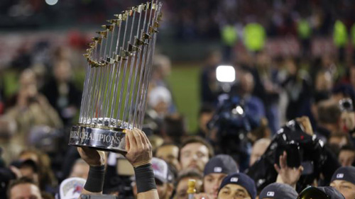 A player holds up the championship trophy after defeating the St. Louis Cardinals in Game 6 of baseballs World Series on Oct. 30, 2013. /AP