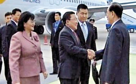 This screen capture from North Korean Central TV shows Mongolian President Tsakhiagiin Elbegdorj shakes hands with Kim Yong-nam, the chairman of the Supreme Peoples Assembly, at an airport in Pyongyang on Oct. 28.