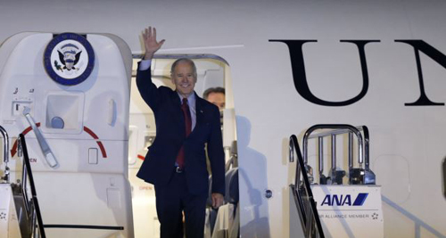 U.S. Vice President Joseph Biden waves upon his arrival at Haneda airport in Tokyo on Dec. 2, 2013. /Reuters