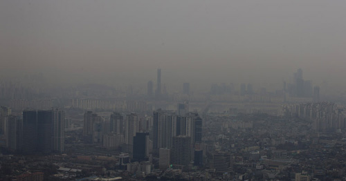 The Seoul skyline is obscured on Monday afternoon as the country braces for a new influx of toxic haze from China.