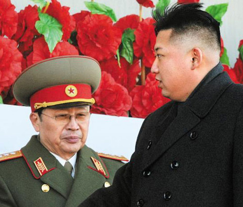 North Korean leader Kim Jong-un and his uncle Jang Song-taek (left) attend a military parade in Pyongyang on Feb. 16, 2013. /Reuters-Newsis