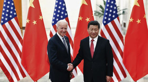 Chinese President Xi Jinping shakes hands with U.S. Vice President Joe Biden (left) inside the Great Hall of the People in Beijing on Dec. 4, 2013. /Reuters
