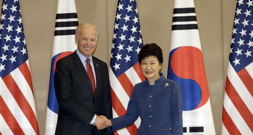 President Park Geun-hye (right) shakes hands with U.S. Vice President Joe Biden before their meeting at Cheong Wa Dae in Seoul on Dec. 6, 2013. /AP