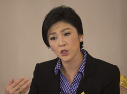 Thai Prime Minister Yingluck Shinawatra speaks during an interview with foreign media at Government House in Bangkok on Dec. 7, 2013. /AP