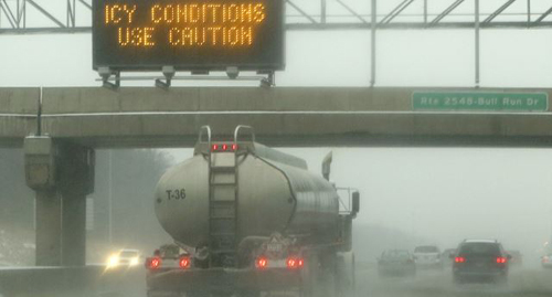 A sign warns drivers of icy conditions on Interstate 66 in Manassas, Virginia, outside of Washington on Dec. 8, 2013. /Reuters