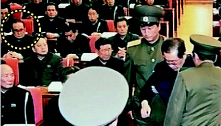 A man (in dotted circle) assumed to be Ri Su-yong looks on as Jang Song-taek is arrested during a Politburo meeting in this screen capture from [North] Korean Central TV on Monday.