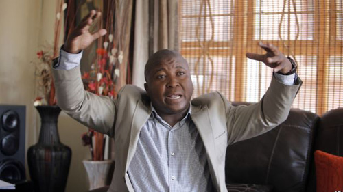Thamsanqa Jantjie gestures at his home during an interview with The Associated Press in Johannesburg, South Africa on Dec. 12, 2013. /AP