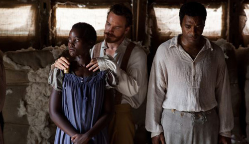 This image released by Fox Searchlight shows Lupita Nyongo, from left, Michael Fassbender and Chiwetel Ejiofor in a scene from