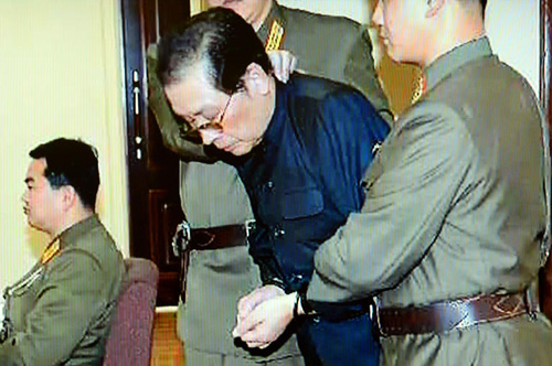 Jang Song-taek is shown with his hands tied with a rope at a military tribunal on Thursday. /News 1