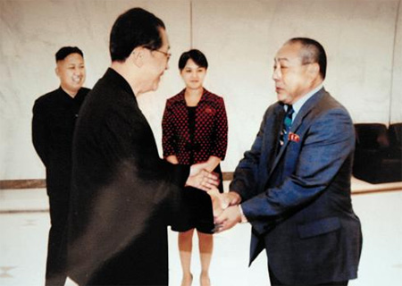 Late North Korean leader Kim Jong-ils former sushi chef Kenji Fujimoto shakes hands with Jang Song-taek during a visit to Pyongyang in July 2012.