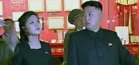 This video grab from the North Korean Central TV shows North Korean leader Kim Jong-un together with his wife Ri Sol-ju.