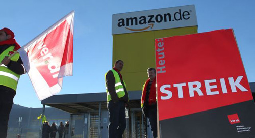 Employees of U.S. online retailer Amazon rally during a strike in front of one of the companys logistics centers in Graben, Germany on Dec. 16, 2013. /AP