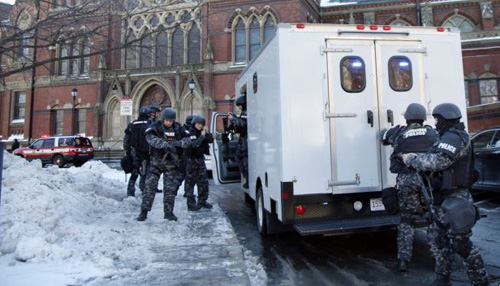 SWAT team officers arrive at a building at Harvard University in Cambridge on Dec. 16, 2013. /AP