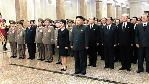 North Korean leader Kim Jong-un and his wife Ri Sol-ju visit the Kumsusan Palace of the Sun on Tuesday, the second anniversary of the death of former leader Kim Jong-il. /[North] Korean Central TV
