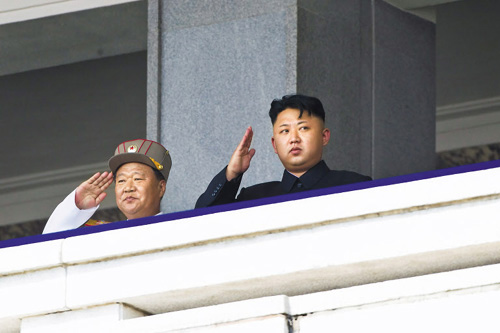Choe Ryong-hae stands next to North Korean leader Kim Jong-un during a military parade in Pyongyang to mark the 60th anniversary of the Korean War armistice on July 27, 2013. /AP