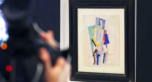 Picassos 1914 cubist drawing LHomme au Gibus, Man with Opera Hat, is presented at Sothebys auction house in Paris on Dec. 12, 2013. /Reuters