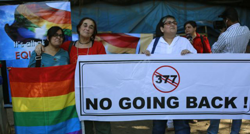 A group of Indian activists hold a banner against section 377 of the Indian Penal Code that criminalizes homosexuality during a protest in Mumbai, India on Dec. 11, 2013. /AP