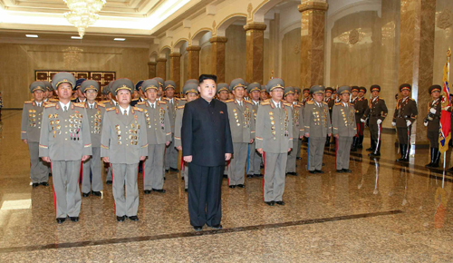 This picture from the Rodong Sinmun daily shows North Korean leader Kim Jong-un with military officers during a visit to the Kumsusan Palace of the Sun in Pyongyang on Dec. 17. In second row are Jang Jong-nam, Choe Ryong-hae and Ri Yong-gil.