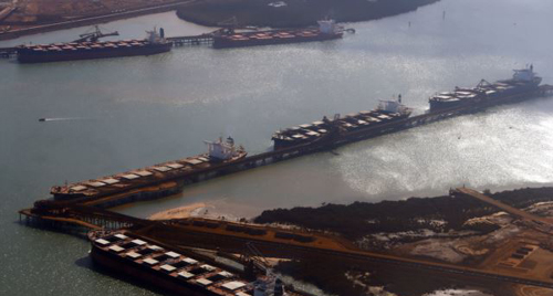 Ships waiting to be loaded with iron ore are seen at Port Hedland in the Pilbara region of Western Australia. /Reuters