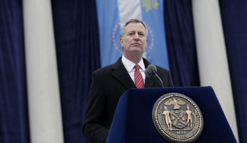 New York City Mayor Bill de Blasio speaks after being sworn in during the public inauguration ceremony at City Hall in New York on Jan. 1, 2014. /AP