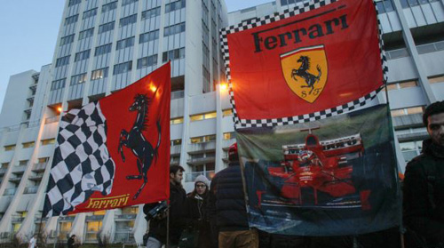 Ferrari flags are seen in front of the CHU Nord hospital emergency unit in Grenoble, French Alps, where retired seven-times Formula One world champion Michael Schumacher is hospitalized after a ski accident on Dec. 31, 2013. /Reuters