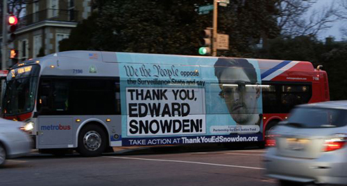 A Washington Metro bus is seen with an Edward Snowden sign on its side panel on Dec. 20, 2013. /Reuters