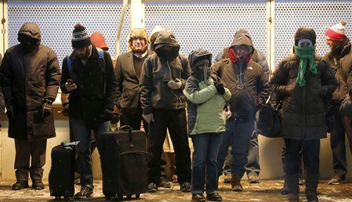 Commuters gather under warming lamps on one of Chicagos famous