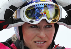 Overall leader of Alpine Skiing World Cup, Lindsey Vonn of the U.S. takes off her mask at the finish area of the Rosa Khutor Alpine skiing, in Krasnaya Polyana near Sochi on Feb. 19, 2012. /Reuters