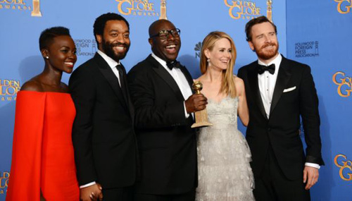 From left, Lupita Nyongo, Chiwetel Ejiofor, Steve McQueen, Sarah Paulson, and Michael Fassbender pose in the press room with the award for best motion picture - drama for