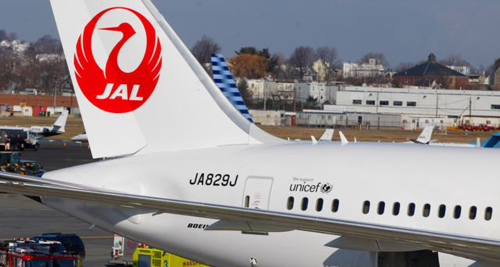 A Japan Airlines Boeing 787 Dreamliner jet surrounded by emergency vehicles at Logan International Airport in Boston. /AP