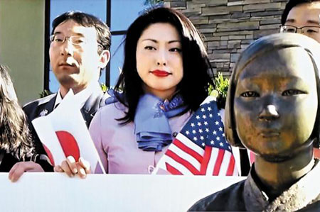 This captured image from cable channel YTN shows Japanese lawmakers protesting to pull down a statue honoring victims of sexual slavery in a park in Glendale, Los Angeles, California on Friday.