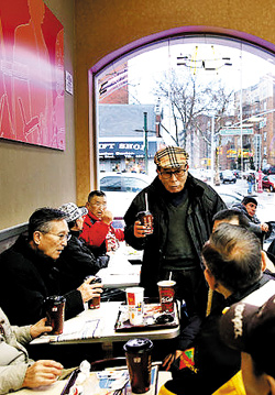 Elderly Korean-Americans sit in a McDonalds in Flushing, New York. /The New York Times