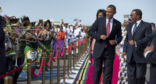 President Barack Obama, followed by first lady Michelle Obama in Tanzania on July 1, 2013 during his week-long trip to Africa. /AP