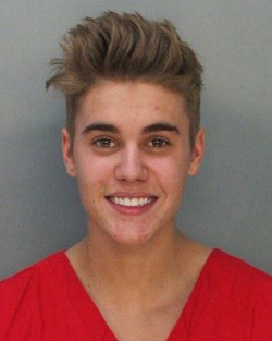 This police booking mug made available by the Miami Dade County Corrections Department shows pop star Justin Bieber on Jan. 23, 2014. /AP
