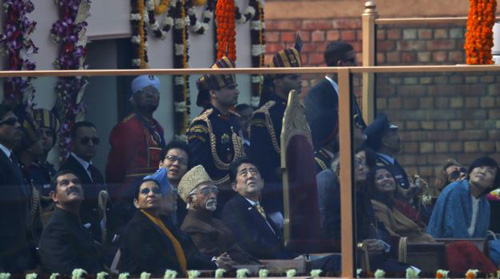 Japanese Prime Minister Shinzo Abe (center) watches Indian fighter planes flying past as the chief guest at the Indian Republic Day parade in New Delhi, India on Jan. 26, 2014. /AP