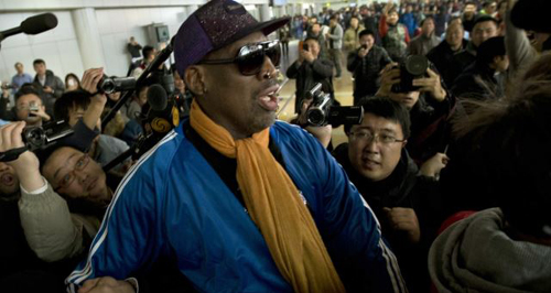Former NBA basketball player Dennis Rodman is followed by journalists as he arrives at the Capital International Airport in Beijing from Pyongyang. /AP