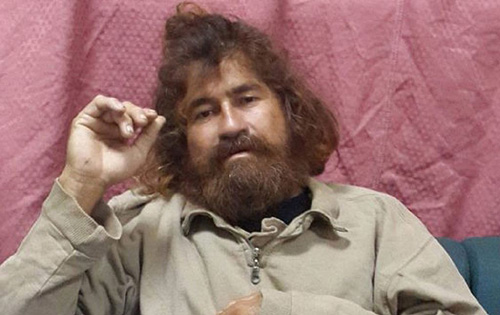 Jose Salvador Alvarenga sits on a couch in Majuro in the Marshall Islands, after he was rescued from being washed ashore on the tiny atoll of Ebon in the Pacific Ocean on Feb. 3, 2014. /AP