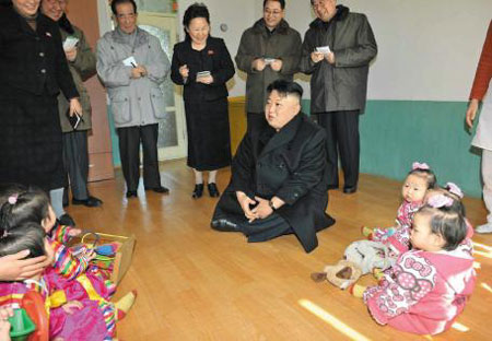 In this photo published by the official Rodong Sinmun daily on Tuesday, North Korean leader Kim Jong-un and other officials visit a nursery in Pyongyang without taking their shoes off.