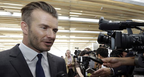 David Beckham responds to a question following a news conference where he announced he will exercise his option to purchase a Major League Soccer expansion team in Miami on Feb. 5, 2014, in Miami. /AP