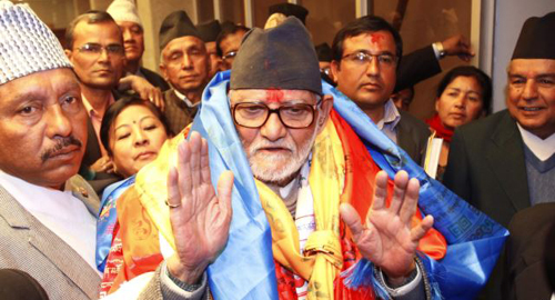 Nepals newly elected Prime Minister Sushil Koirala waves to the media at the Constitution Assembly Hall in Katmandu, Nepal on Feb. 10, 2014. /AP