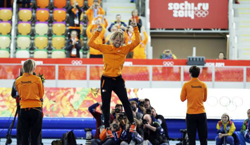 Gold medalist Michel Mulder from the Netherlands jumps in celebration, flanked by Silver medalist Jan Smeekens (right) and bronze medalist Ronald Mulder during the flower ceremony for the mens 500-m speed skating race at the Adler Arena Skating Center in Sochi, Russia on Feb. 10, 2014. /AP