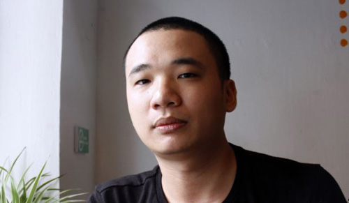 Nguyen Ha Dong, the author of the game Flappy Bird. relax inside a coffee shop in Hanoi on Feb. 5, 2014. /AFP