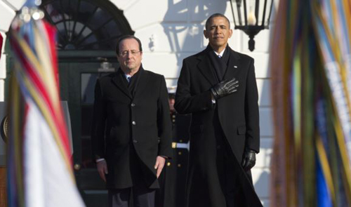 President Barack Obama and French President François Hollande stand for the national anthem during a state arrival ceremony on the South Lawn of the White House in Washington on Feb. 11, 2014. /AP